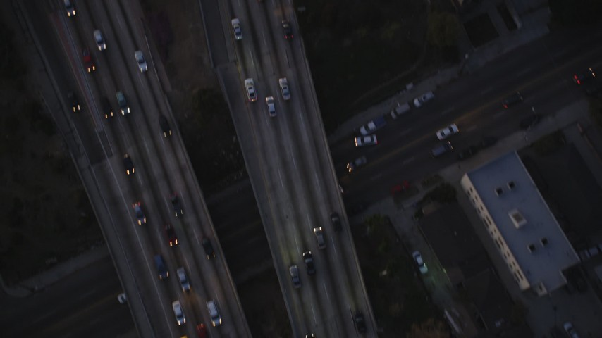 5K stock footage aerial video bird's eye view of light traffic on Highway 101 in Hollywood at twilight, California Aerial Stock Footage | DCLA_270