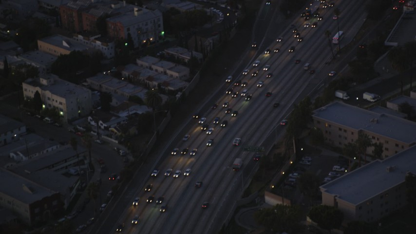 Bird's Eye of Heavy Traffic on Highway 101 at twilight in Hollywood, California Aerial Stock Footage | DCLA_272
