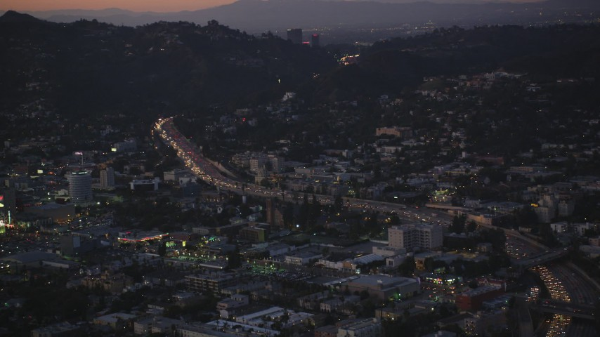 5K stock footage aerial video of heavy traffic on Highway 101 by Hollywood at twilight, California Aerial Stock Footage | DCLA_274