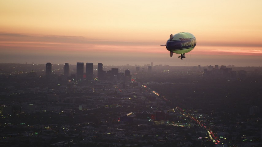 5K aerial stock footage video of approaching a blimp near Century City skyscrapers at twilight, California Aerial Stock Footage | DCLA_278