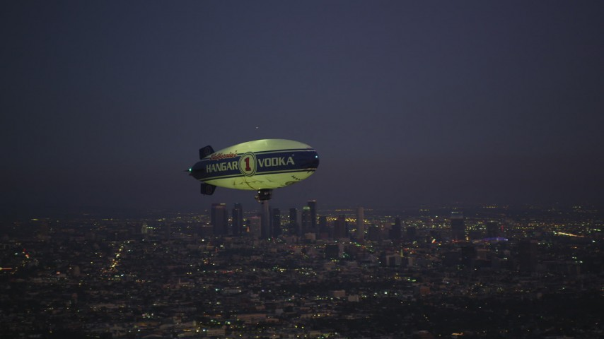 5K stock footage aerial video of flying by an advertising blimp and reveal Downtown Los Angeles skyline at twilight, California Aerial Stock Footage | DCLA_279
