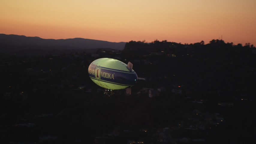 5K stock footage aerial video orbit blimp flying near the Hollywood Hills at twilight, California Aerial Stock Footage | DCLA_281