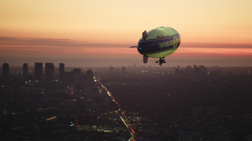 5K stock footage aerial video of tracking a blimp flying near Century City at twilight, California Aerial Stock Footage | DCLA_282