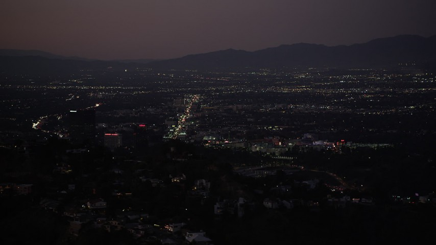 5K stock footage aerial video of Universal City office buildings seen from Hollywood Hills at night, California Aerial Stock Footage | DCLA_283