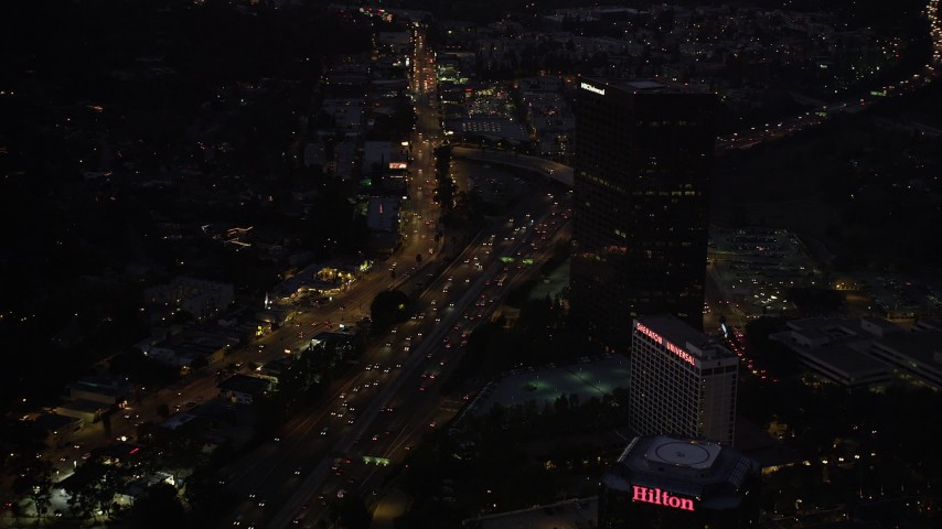 5K stock footage aerial video of light Highway 101 traffic in Universal City at night, California Aerial Stock Footage | DCLA_286