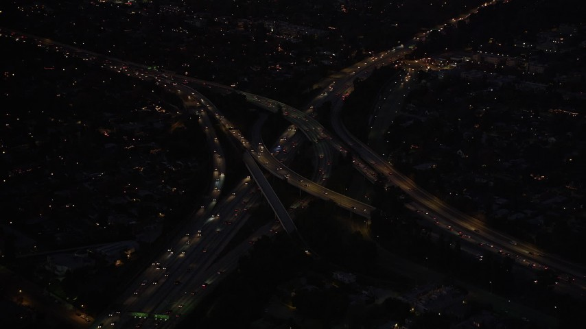 5K stock footage aerial video approach Hollywood Split freeway interchange at night in North Hollywood, California Aerial Stock Footage | DCLA_288
