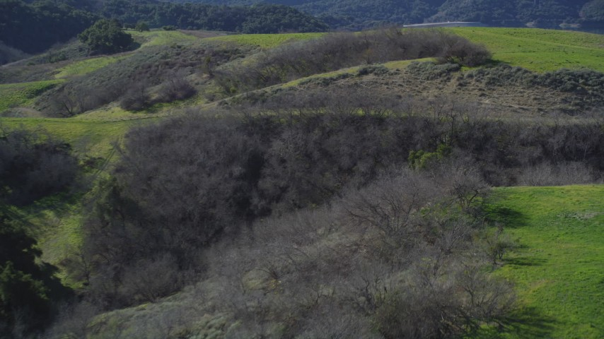 5K stock footage aerial video Flying over a small canyon in the hills, Lake Casitas, Ventura, California Aerial Stock Footage | DCSF01_004