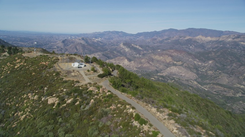 5K stock footage aerial video Follow mountain ridge summit to cell phone tower, Santa Ynez Mountains, California Aerial Stock Footage | DCSF01_009