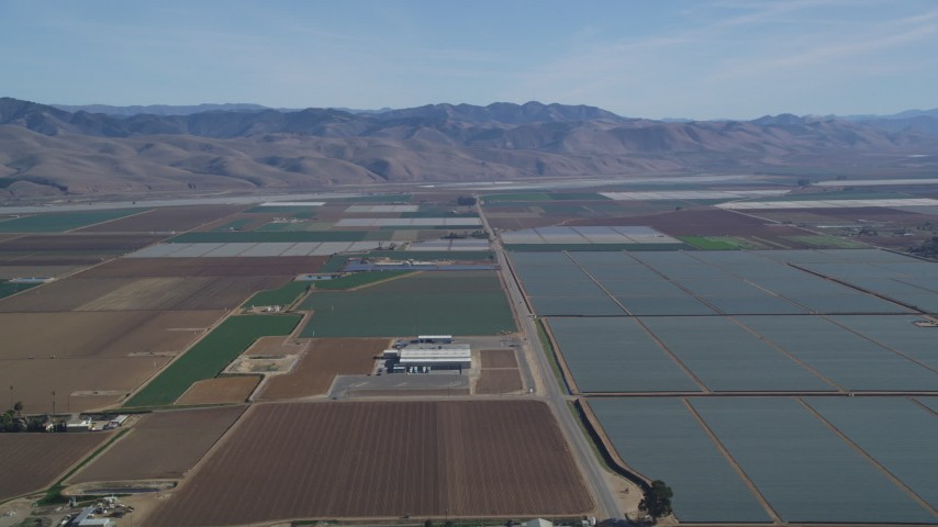 5K stock footage aerial video Fly by geometric fields of farmland, Sierra Madre Mountains, Santa Maria, California Aerial Stock Footage | DCSF02_001