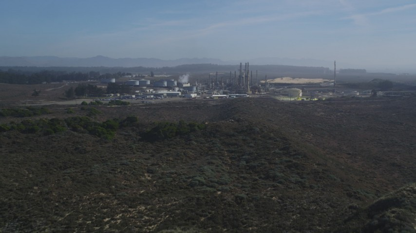 5K stock footage aerial video Tilt from Pismo Dunes, reveal Phillips 66 Company Santa Maria Refinery, Arroyo Grande, California Aerial Stock Footage | DCSF02_004