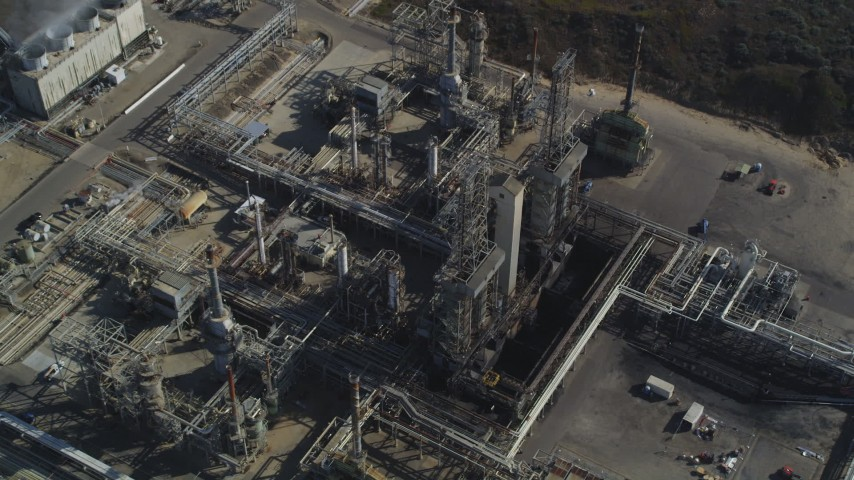 5K stock footage aerial video Tilt to bird's eye of flare stacks and structures at Phillips 66 Company Santa Maria Refinery, Arroyo Grande, California Aerial Stock Footage | DCSF02_007