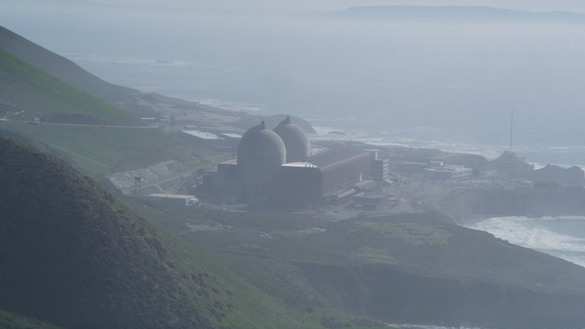 5K stock footage aerial video Flying into the hills, eclipsing Diablo Canyon Power Plant, Avila Beach, California Aerial Stock Footage | DCSF02_022