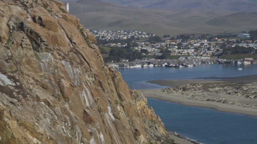 5K stock footage aerial video Flying by Morro Rock to reveal Dynegy Morro Bay power plant, Morro Bay, California Aerial Stock Footage | DCSF03_002