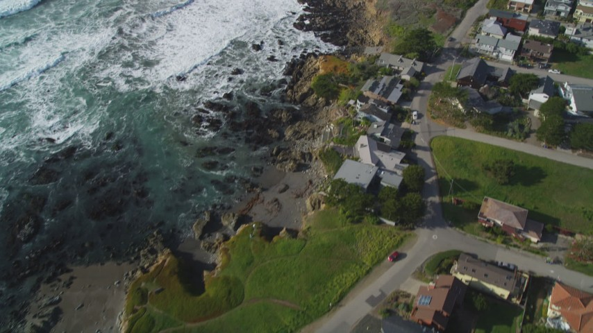 5K stock footage aerial video Tilt from oceanfront homes to reveal Moon Stone Beach, Cambria, California Aerial Stock Footage | DCSF03_012