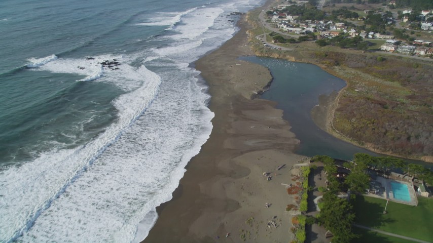 5K stock footage aerial video Tilt from Moon Stone Beach to reveal homes on the coast, Cambria, California Aerial Stock Footage | DCSF03_013
