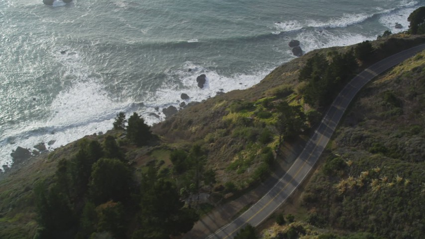 5K aerial video Bird's eye view of Highway 1 winding along hills above the coast, Big Sur, California Aerial Stock Footage | DCSF03_033