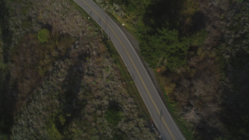 5K aerial video Bird's eye view of Highway 1 winding past hills, Big Sur, California Aerial Stock Footage | DCSF03_035