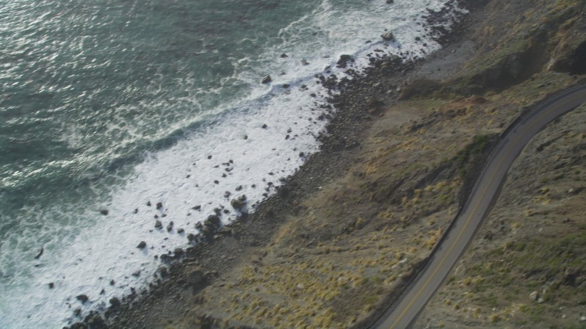 5K stock footage aerial video Bird's eye view of ocean waves, reveal Highway 1, Big Sur, California Aerial Stock Footage | DCSF03_036