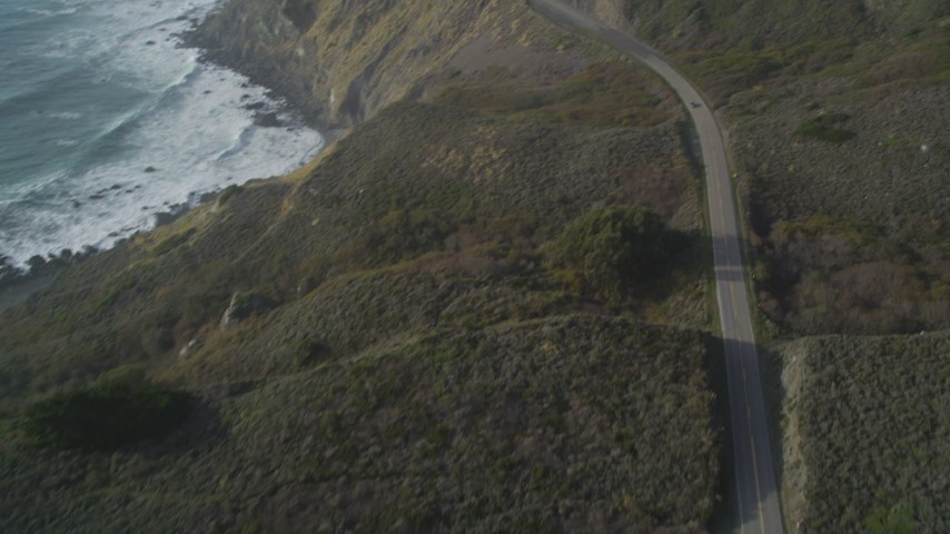 5K stock footage aerial video Tilt from bird's eye of Highway 1 above the coastline, Big Sur, California Aerial Stock Footage | DCSF03_037