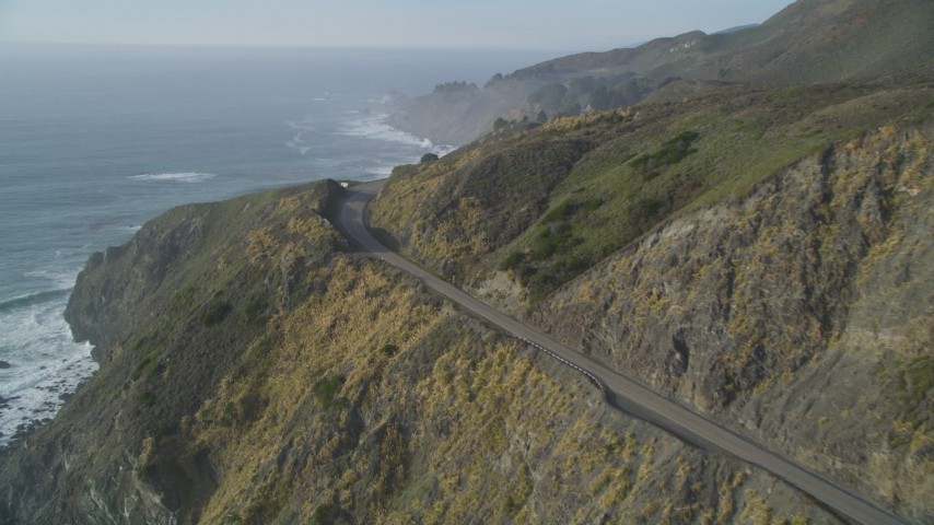 5K stock footage aerial video Approach a bend in Highway 1 in the hills above the coastline, Big Sur, California Aerial Stock Footage | DCSF03_038