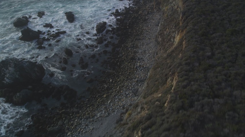 5K aerial video Bird's eye view of waves slamming into coastal rock formations, Big Sur, California Aerial Stock Footage | DCSF03_042