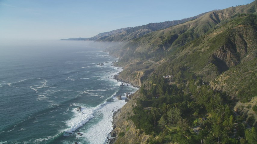 5K aerial video Follow the coast and fly over steep cliffs, Big Sur, California Aerial Stock Footage | DCSF03_048