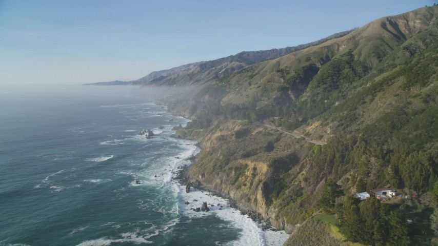 5K stock footage aerial video Fly over coastal cliffs and ocean waves, Big Sur, California Aerial Stock Footage DCSF03_049 | Axiom Images