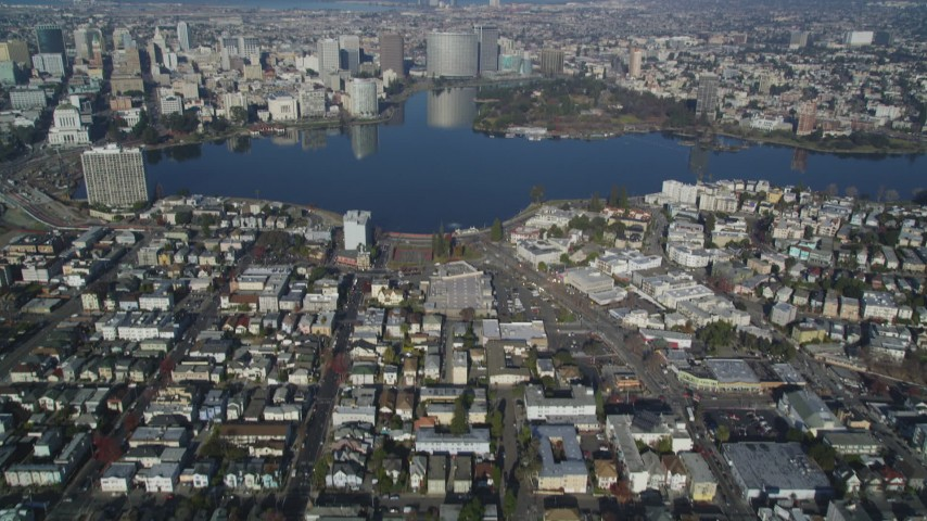 5K stock footage aerial video Tilt from an urban neighborhood, reveal and approach Lake Merritt, Downtown Oakland, California Aerial Stock Footage | DCSF05_001
