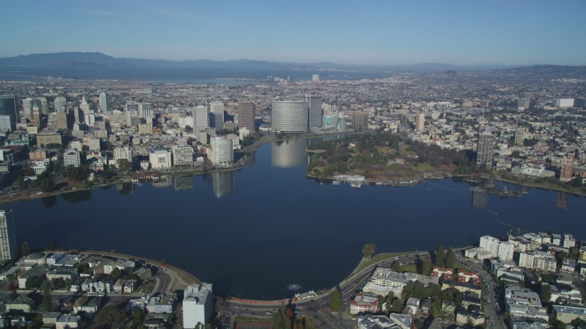 5K stock footage aerial video Approach Lake Merritt, Lakeside Park, and Downtown Oakland, California Aerial Stock Footage | DCSF05_002