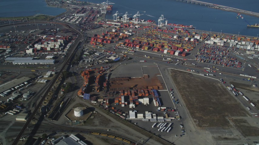 5K stock footage aerial video Approach shipping containers at the Port of Oakland, California Aerial Stock Footage | DCSF05_003