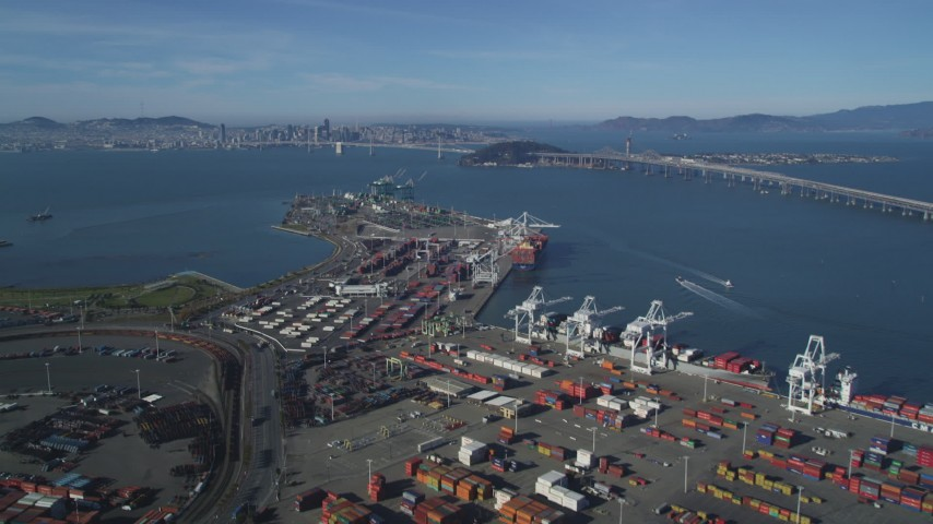 5K stock footage aerial video Tilt from shipping containers at the Port of Oakland, reveal Bay Bridge, San Francisco Bay, California Aerial Stock Footage | DCSF05_004