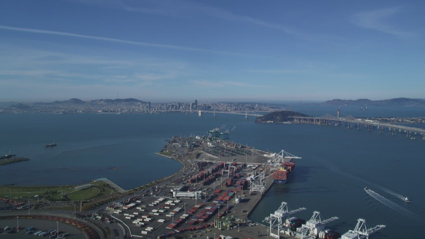 5K stock footage aerial video Fly over the Port of Oakland to approach the Bay Bridge and San Francisco Bay, California Aerial Stock Footage | DCSF05_005