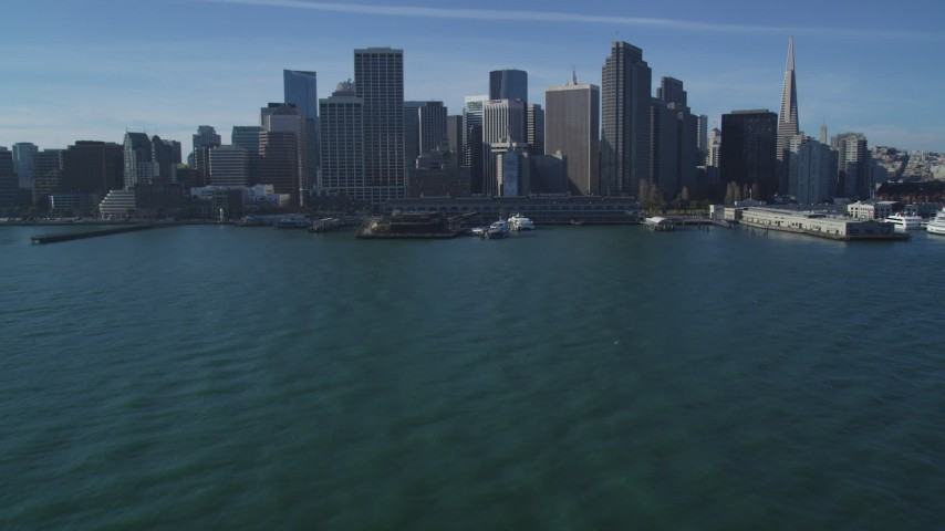 5K stock footage aerial video Tilt from San Francisco Bay to reveal the Ferry Building, Downtown San Francisco, California Aerial Stock Footage | DCSF05_007