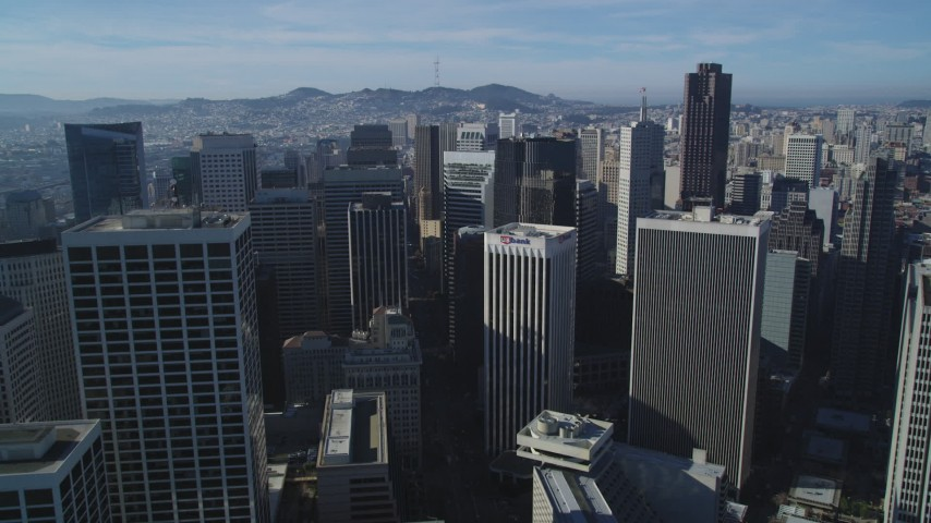 5K stock footage aerial video Flying over Market Street and downtown skyscrapers, Downtown San Francisco, California Aerial Stock Footage | DCSF05_009