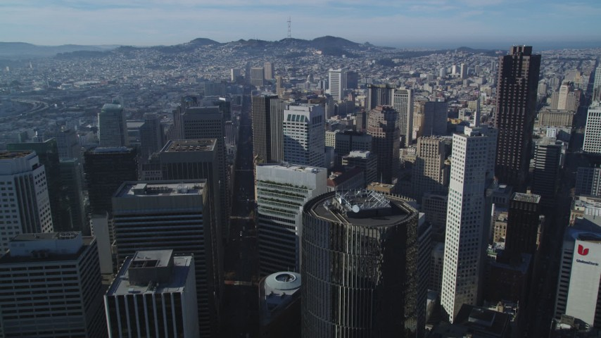 5K stock footage aerial video Fly over skyscrapers and high-rises in Downtown San Francisco, California Aerial Stock Footage | DCSF05_010