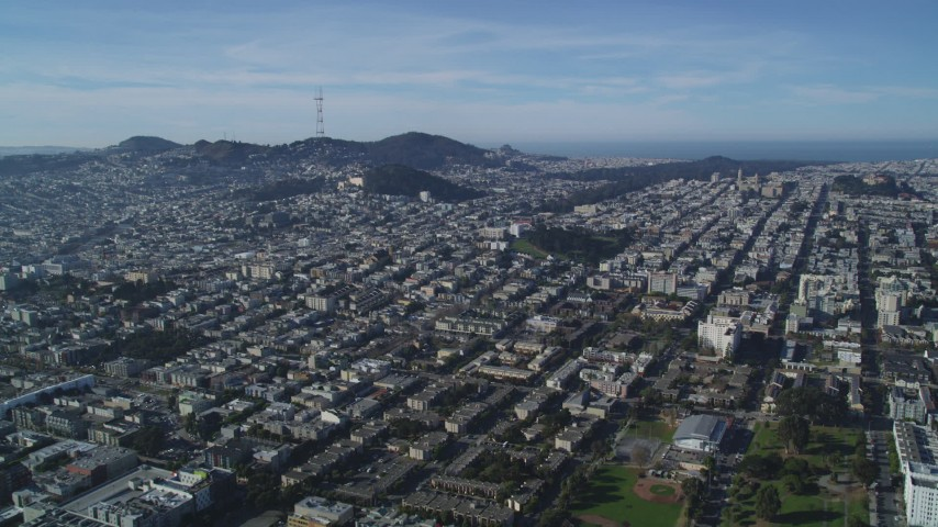 5K stock footage aerial video Fly over urban neighborhoods toward Alamo Square Park, Golden Gate Park, and Mount Sutro, Western Addition, San Francisco, California Aerial Stock Footage DCSF05_014 | Axiom Images
