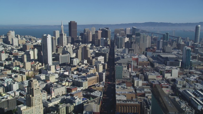 5K stock footage aerial video Follow Market Street, tilt to reveal skyscrapers, Downtown San Francisco, California Aerial Stock Footage | DCSF05_015