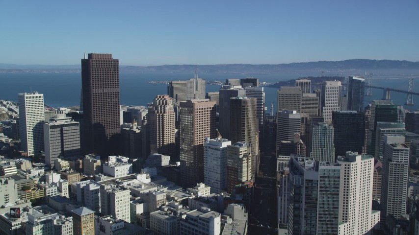 5K stock footage aerial video Follow Market Street, tilt to reveal Financial District skyscrapers, Downtown San Francisco, California Aerial Stock Footage | DCSF05_016