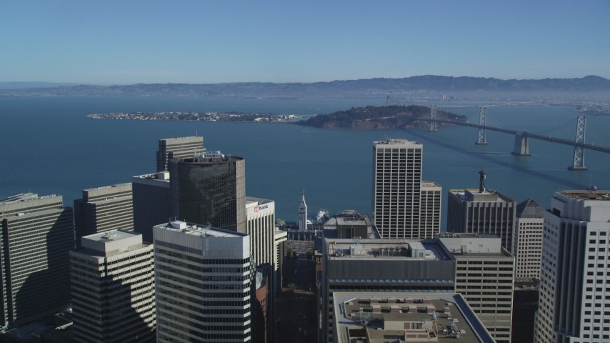 5K stock footage aerial video Approach islands in the San Francisco Bay and tilt to the Ferry Building, Downtown San Francisco, California Aerial Stock Footage | DCSF05_019