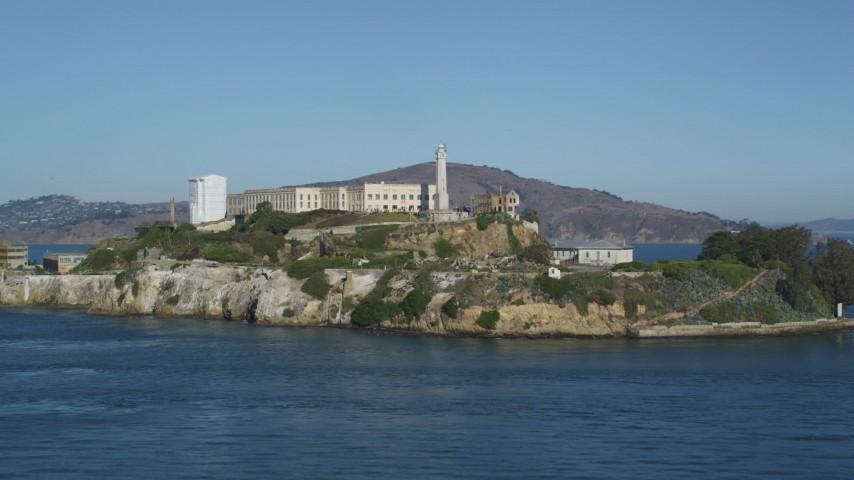 5K stock footage aerial video Fly low over San Francisco Bay, approach Alcatraz, San Francisco, California  Aerial Stock Footage | DCSF05_024