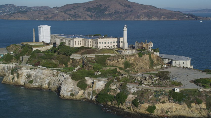 Approach and flyby the main building and lighthouse of Alcatraz, San Francisco, California Aerial Stock Footage | DCSF05_025