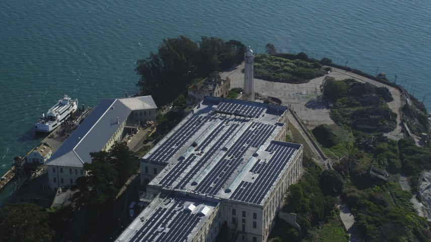 Orbiting the main building and the lighthouse on Alcatraz, San Francisco, California Aerial Stock Footage | DCSF05_027