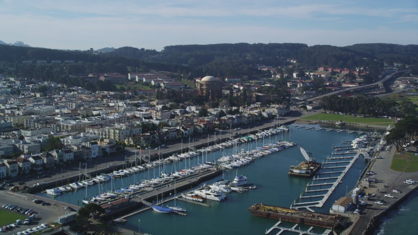5K stock footage aerial video Tilt from San Francisco Bay to reveal Yacht Harbor and Palace of Fine Arts, San Francisco, California Aerial Stock Footage | DCSF05_030