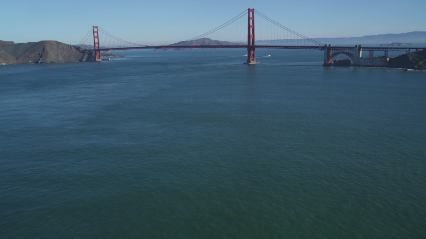 5K stock footage aerial video Tilt from San Francisco Bay to reveal and approach the Golden Gate Bridge, San Francisco, California Aerial Stock Footage | DCSF05_038