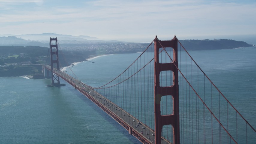 5K stock footage aerial video Flying by the Golden Gate Bridge with light traffic crossing the span, San Francisco, California Aerial Stock Footage | DCSF05_042