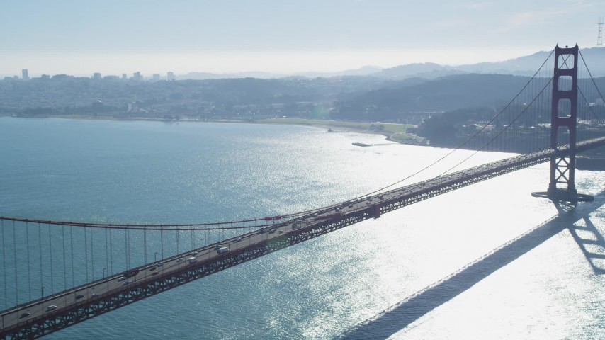 5K stock footage aerial video Flying by Golden Gate Bridge with the downtown skyline in distance, San Francisco, California Aerial Stock Footage | DCSF05_043