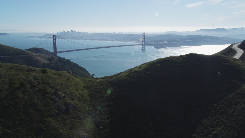 5K stock footage aerial video Golden Gate Bridge and downtown skyline seen from the Marin Headlands, Marin County, California Aerial Stock Footage | DCSF05_044