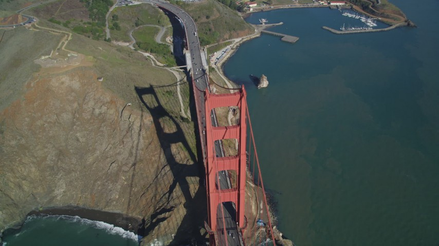 5K stock footage aerial video Tilt to bird's eye view of Golden Gate Bridge, and Highway 101, San Francisco, California Aerial Stock Footage | DCSF05_046
