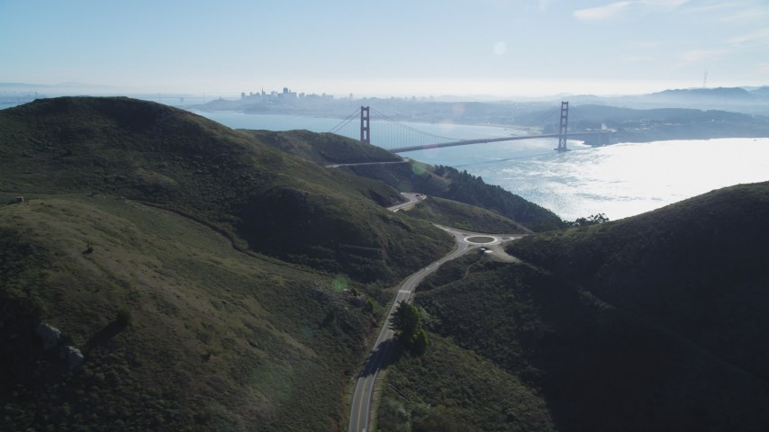 5K stock footage aerial video Flyby the Marin Headlands, eclipsing Golden Gate Bridge, San Francisco skyline in background, Marin County, California Aerial Stock Footage | DCSF05_047