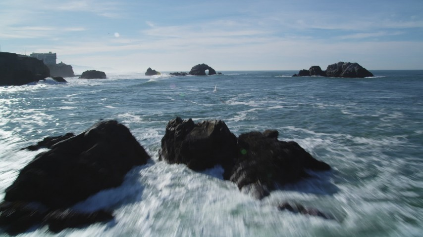 5K stock footage aerial video Tilt from the Pacific Ocean revealing Seal Rocks, San Francisco, California Aerial Stock Footage | DCSF05_051